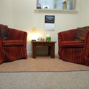 Two armchairs set up for counselling